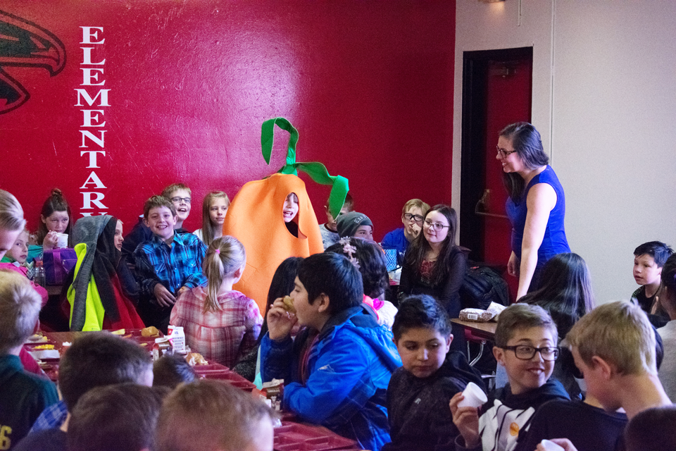 Keenan Waldroup poses in a carrot costume in front of his peers at the Harvest of the Month event.